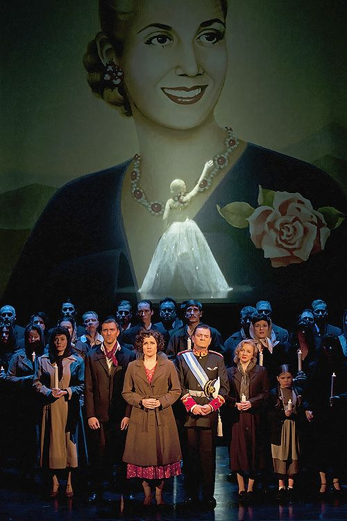 A scene from Tampereen Työväen Teatteri's production of Evita. In the middle, Juha-Matti Koskela as Che, Laura Alajääski as Eva and Mika Honkanen as Juan Perón. Photo by Teppo Järvinen.