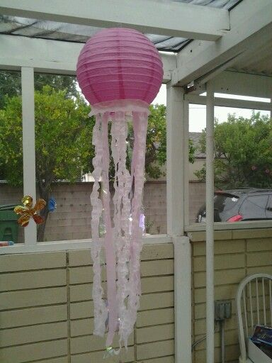 Home made jelly fish ( sponge bob birthday theme) Super easy...I used pink paper lanterns for the body, cellophane and pink tissue paper for the stingers :)