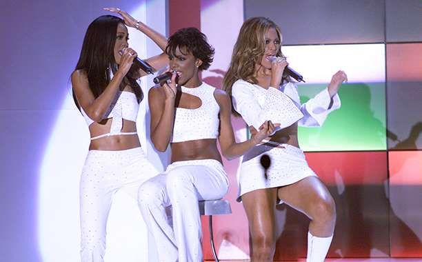 Destiny's Child's Best Matching Outfits. Michelle Williams, Kelly Rowland, and Beyonce Knowles at the 2000 VH1 Vogue Fashion Awards - Scott Gries/Getty Images