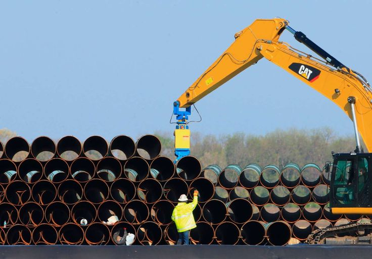 FILE - In this May 9, 2015 file photo, pipes for the proposed Dakota Access oil pipeline, that would... - AP Photo/Nati Harnik, File