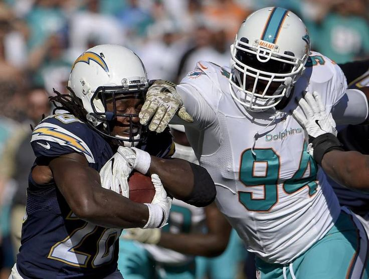 Dolphins vs. Chargers:  31-24, Dolphins  -  November 13, 2016  -     San Diego Chargers running back Melvin Gordon, runs past Miami Dolphins defensive end Mario Williams during the first half of an NFL football game in San Diego on Nov. 13, 2016. Denis Poroy AP