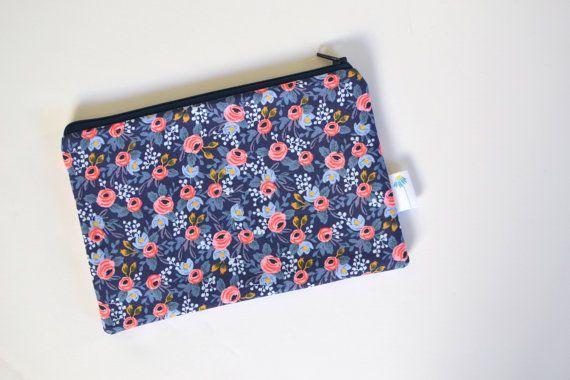 ♥WHY WE MADE THIS♥ Things are just better when your life is organized. And pretty. Its a win-win! This gorgeous floral fabric, designed by Rifle Paper Co, will make you want to sort and organize all the things! ♥WHY YOULL LOVE IT♥ No more searching the bottom of your bag for all those little essentials. Pouches keep them organized (and pretty). Use it for: ◇pens, pencils, and art supplies ◇makeup brushes ◇stashing essentials when running errands - phone, keys, credit cards, chapstick ◇hiding…