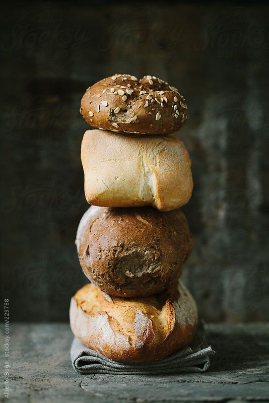 Close up of different kinds of bread. by Alberto Bogo Available to license at Stocksy.com