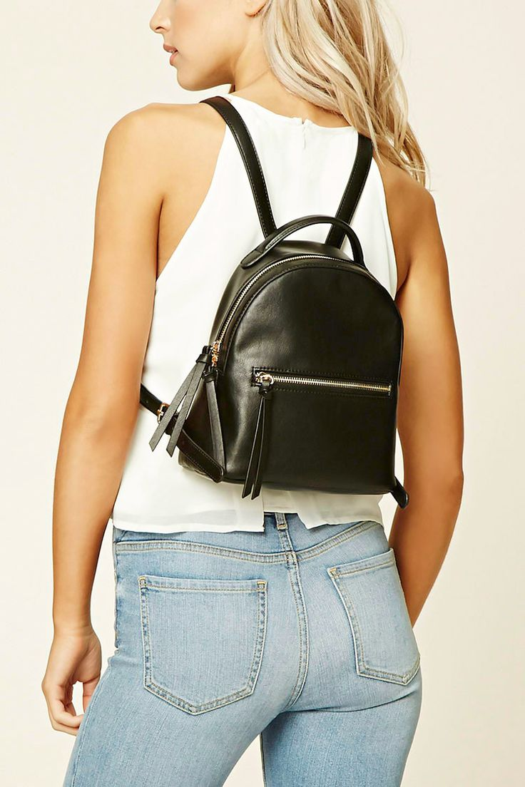 A mini backpack featuring a faux leather exterior with a zipper compartment and pocket, an interior zipper pocket, and adjustable straps with high-polish buckles.