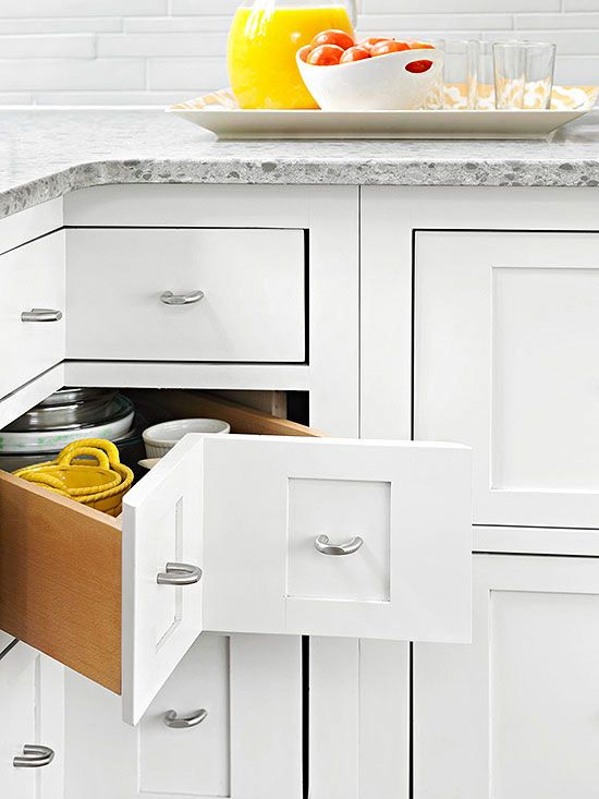 Love these corner cabinets! More storage ideas: http://www.bhg.com/kitchen/storage/organization/storage-packed-cabinets-drawers/?socsrc=bhgpin123013cornercabinetspage=19