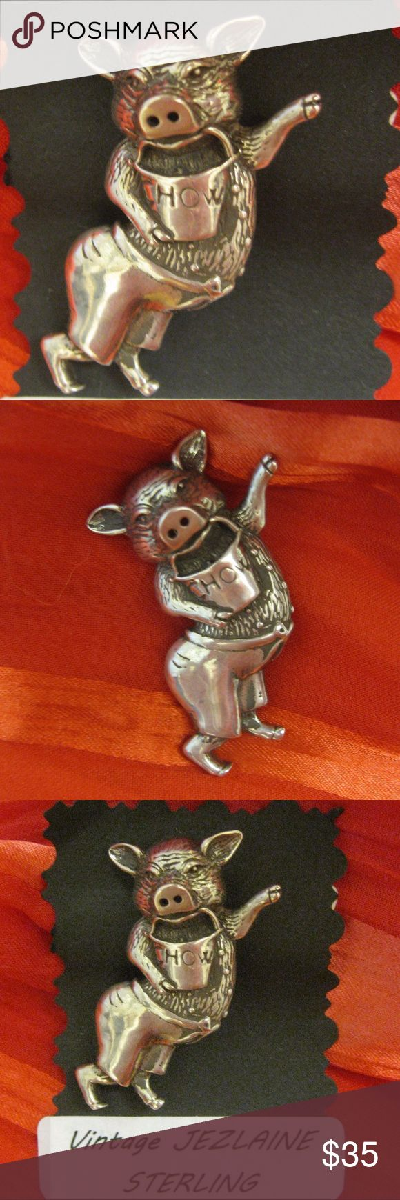 "Vintage JEZLAINE Sterling Silver Pig Hog Brooch Charming 1980s detailed dimensional sterling silver pig by JEZLAINE. This little critter wears pants cinched with a bowed rope belt and carries a bucket marked ""CHOW"".  No detail is left undone, from his little pig hairs to the facial features to the split hooves.  So cute!!  Secure rollover clasp.  Perfect for your collection or for that farm animal loving friend. Signed ""JS 925 ©"".  1 1/2"" x 1"" x 1/2"". 7.5g  (1017NS-274) Jezlaine Sterling…"