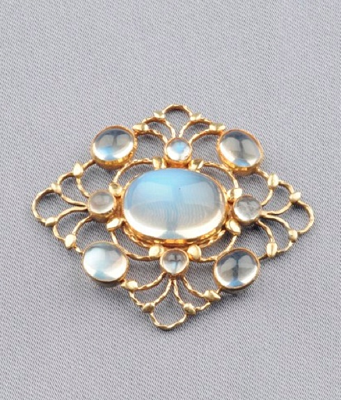 Arts & Crafts 15kt Gold and Moonstone Pendant, Liberty & Co., London, bezel-set with cabochon moonstones within a frame of stylized vines and diminutive leaves, lg. 1 1/2 in., signed L & Co.