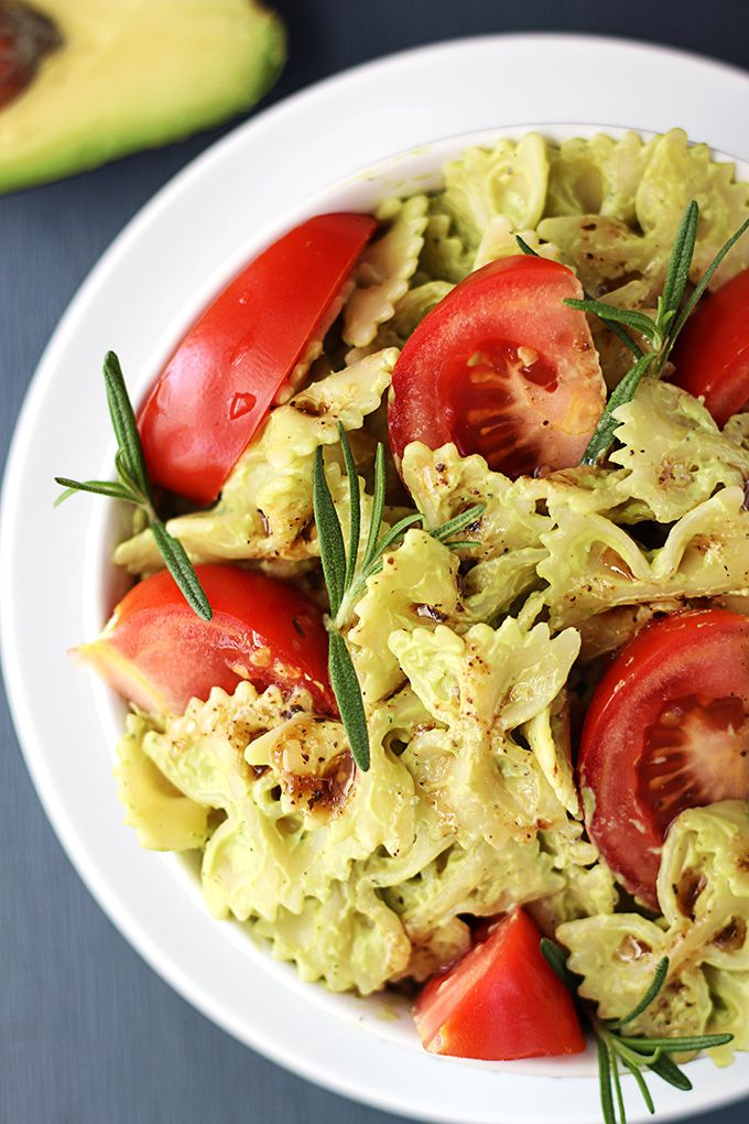 This quick vegetarian pasta is tossed in a creamy avocado sauce that is to-die-for yummy, then drizzled with balsamic dressing for an extra level of flavor! A healthy and satisfying summer dish!