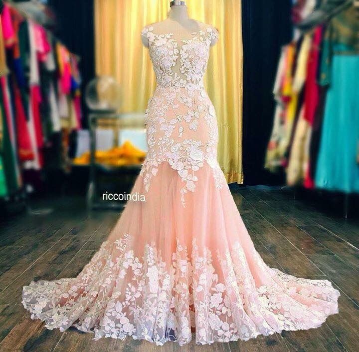 Statement bridal gown in fish cut with train