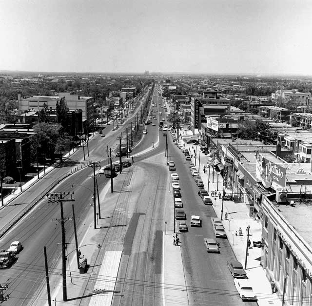 Decarie Boulevard as seen in 1961, before it became a sunken expressway. Snowdon building on the right and the building in the bottom right corner being near the intersection of Queen Mary and Décarie. image source unkown