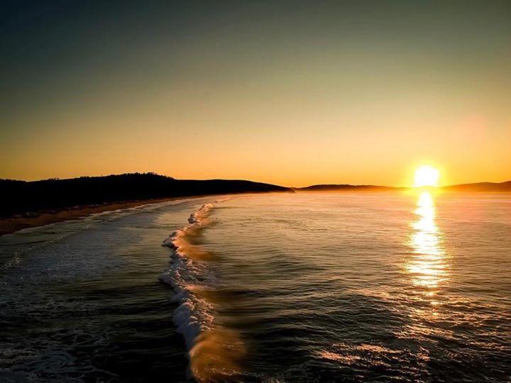 Sunrise over Goats Beach at South Arm near Hobart. Image sent in by Alex McAndrew https://instagram.com/p/Bb6ebM_FvqN/