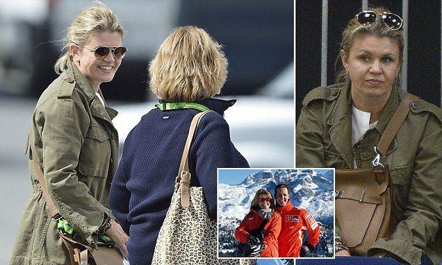 Schumacher's wife Corinna raises a smile in rare public appearance