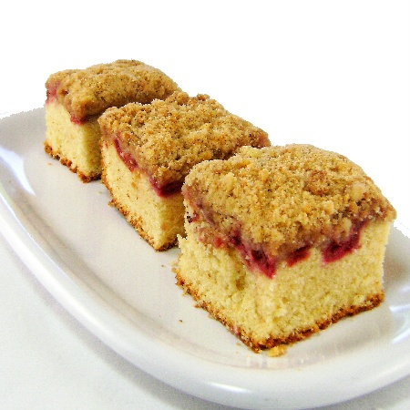 Sour Cherry Crumb Cake, Topping  2 tablespoons unsalted butter, melted, plus more for dish  1/3 cup all-purpose flour, plus more for dish  2 tablespoons granulated sugar  2 tablespoons packed light-brown sugar  1/8 teaspoon salt  1/4 teaspoon ground cinnamon Cake  1 -1/2 c  flour  1 teaspoon baking powder  1/4 tsp salt  (1 stick) unsalted butter, softened  3/4 c sugar  2  eggs  3/4 tsp vanilla extt  1/2 tsp almond extr  1/4 c buttermilk  2 1/2 c  sour cherries, pitted