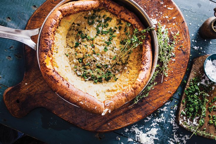 Dutch Baby side dish with flour, parmesan and eggs--from the NY Times' Melissa Clark via KCRW's Good Food.