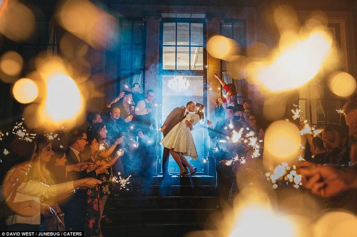 The sparklers in this photograph help to give it it's magical and romantic feel...