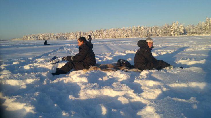 Ice-fishing by snowmobile - Rovaniemi, Lapland, Finland