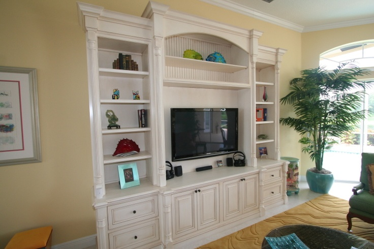 - I like how the tv section comes out more, this could solve the issue of the components underneath without having the rest of the unit as deep. Love it with the white trim.
