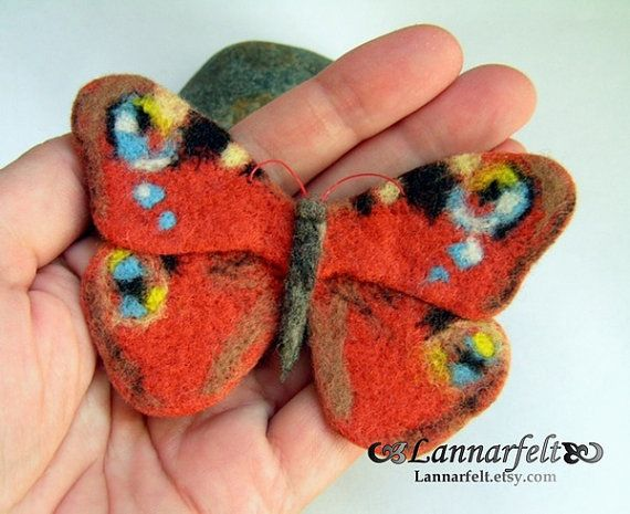 Hand Felted Brooch Butterfly Orange peacock is a super accessory! It can adorn up any jacket, hat, shirt or handbag!  Felt Brooch Butterfly measures about 6,5 * 9 cm and it has a securely attached pin on the back.  Materials: 100% merino wool, pin to affix Techniques:. Wet felting 100% handmade for sure.   Delicate dry cleaning, if very soiled can be slightly moisten the place of pollution and gently rub the soap, without deforming , gently rinse and squeeze squeezing both sides of the…