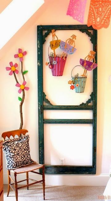 Hm, what if the screen door had chicken wire and was used for storing stuff that hangs from hooks?  Like kitchen tools or jewelry or gardening tools or...?  ~  Dishfunctional Designs: New Looks For Old Salvaged Doors: More Repurposed Door Ideas!