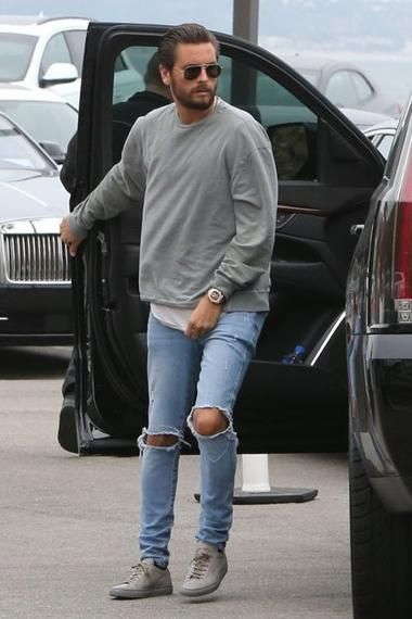 Scott Disick wearing Common Projects Original Achilles Leather Sneakers in Warm Grey, Ksubi Van Winkle Jeans in Non Cents and John Elliott Oversized Crewneck Pullover in Washed Olive