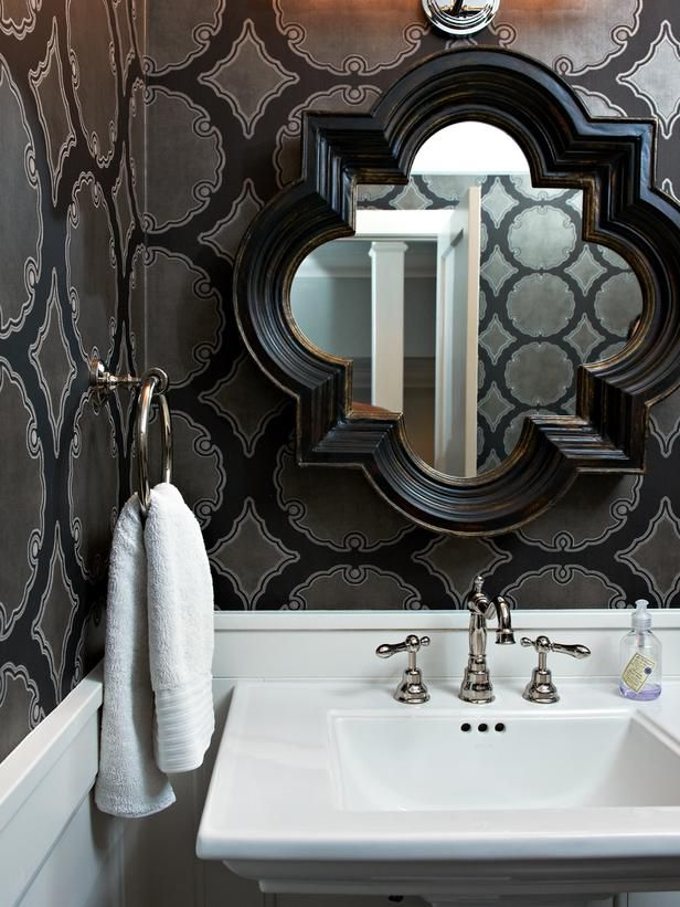Bold Black Wallpaper Plays Up The Drama While A White Pedestal Sink Saves Space In This Small Bathroom A Geometric Mirror The Same Width As The Sink