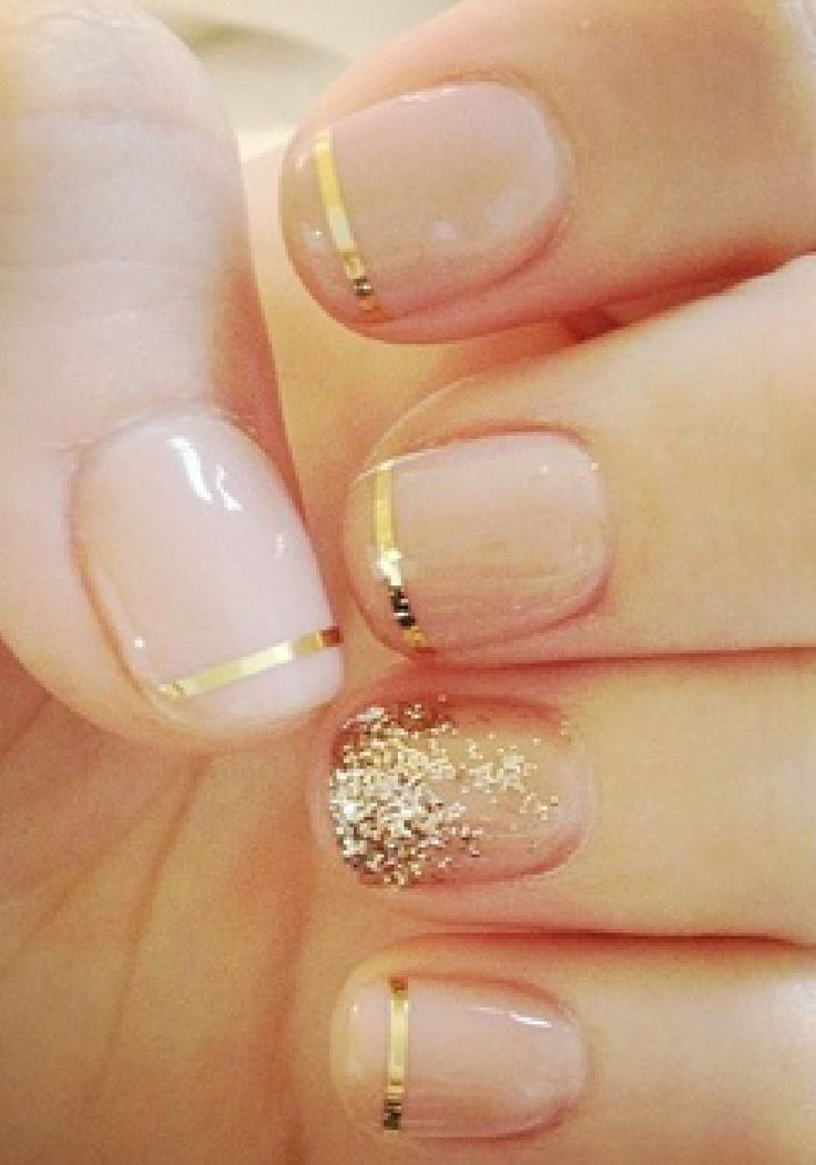 Nude mani with a little bit of gold glitter.