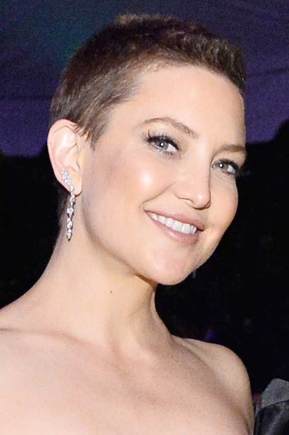 Kate Hudson showed off her new buzz cut as she attended the amfAR Gala in Beverly Hills with her TWO moms! Wearing a David Koma outfit with APM Monaco earrings and John Hardy jewelry the 38 year old mom of two looked stunning and turned heads with her new short do! Photo courtesy of Image.net