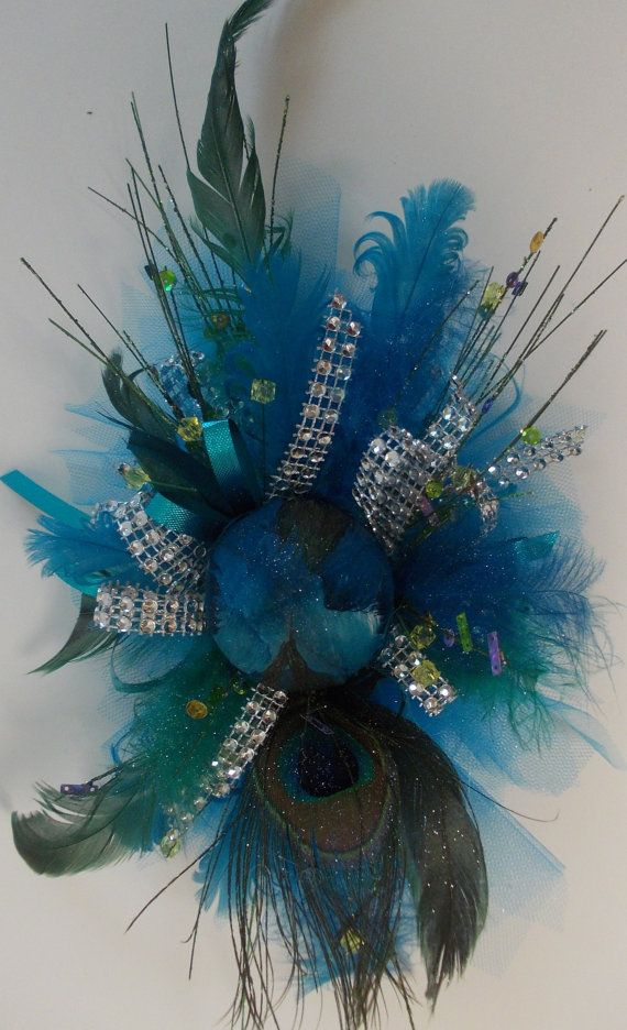 Gorgeous peacock inspired silk wrist corsage on matching bracelet style wristlet. We can make a matching boutonniere for only $12.95. Due to