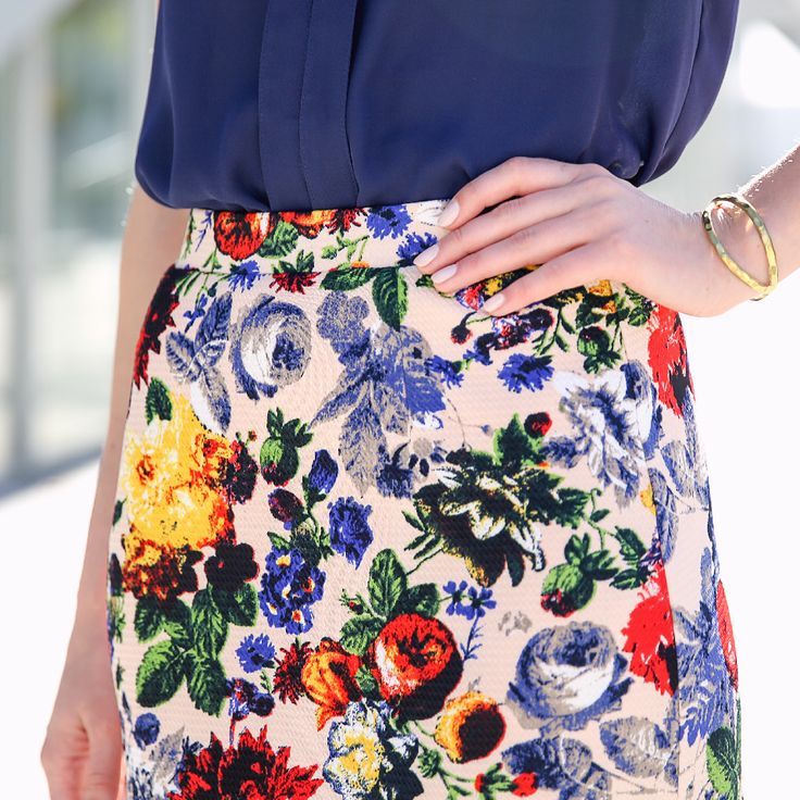 Liven up your look! Start with a bold print—like this amazing still-life floral skirt—to shake up your go-to blouse routine.