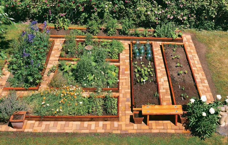 Neat and attractive paths are a garden highlight. The raised beds have been returned to their pre-retrofit height by layering 2x2s on top of each board.Click To Enlarge