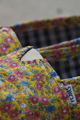 Tutorial: Take your old worn-out TOMS and make them cute and new again with some fabric and fabric glue!