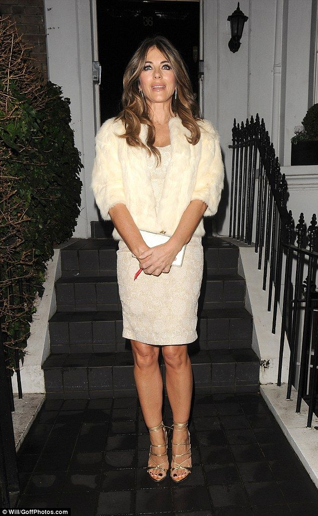 Liz Hurley is showing how to look fabulous with a pair of Dsquared2 golden sandals | Buy ➜ https://shoespost.com/liz-hurley-showing-look-fabulous-pair-dsquared2-golden-sandals/