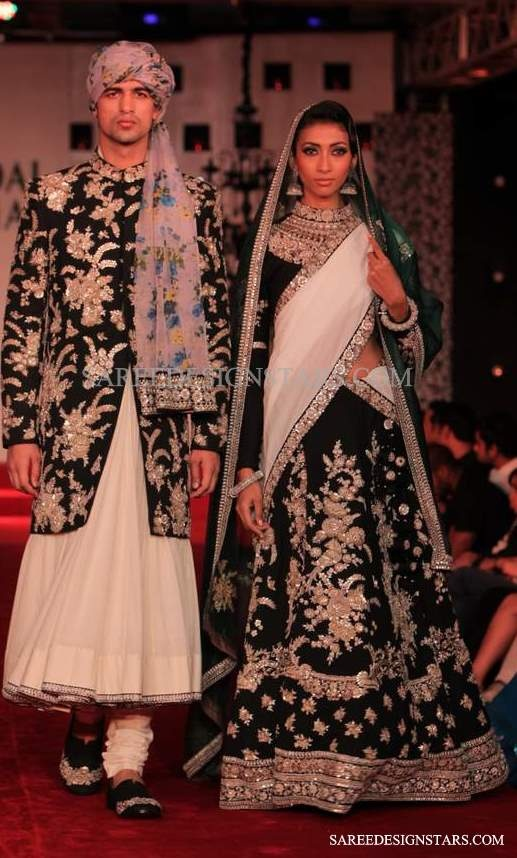 sabyasachi love the white and black it evokes a sense of elegance and class