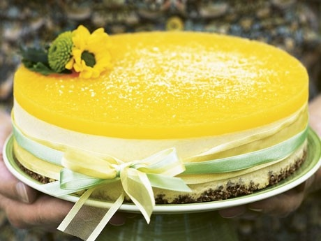 Lemon and Orange Cheesecake - Ingredients: 200 g digestive biscuits,  75 gramsbutter. For the Filling: 5 pcsleaves of gelatine, 5 dl whipped cream  6 pcs egg yolks, 3.2 dl Icing 500 gcream cheese 1.5 cups lemon juice , freshly squeezed.  For the Jelly Glaze: 3 cupsorange juice , freshly squeezed, 2 pcs leaves of gelatine