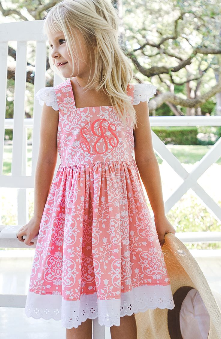 Dress up your girl in this sweet dress with eyelet lace and damask print!