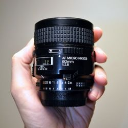 The Nikon 60mm f/2.8D AF Micro-Nikkor is not only my Nikon macro lens, it's my favorite lens in general. In Nikon lenses, only Micro Nikkors offer true macro. The Nikkor 18-55 DX and 70-300 z…