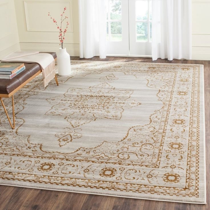 Safavieh's Serenity collection is inspired by timeless traditional designs crafted with the softest polypropylene available. This rug is crafted using a power-loomed construction with a polypropylene