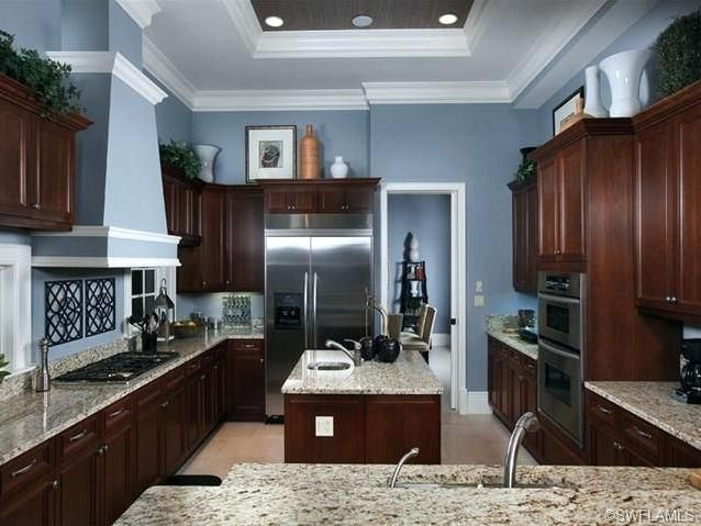 Best Gray Paint With Cherry Cabinets I Like This Wall Color And Its Nice That The Floor Is Lighter Blue Kitchen Walls Popular Kitchen Colors Grey Blue Kitchen