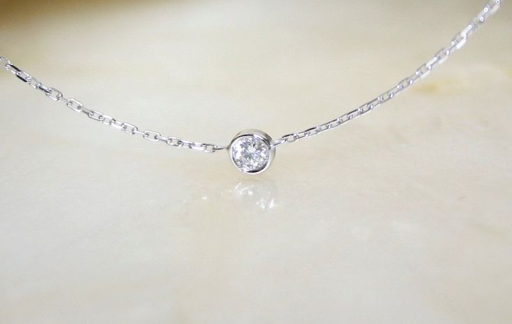 Solitaire diamond and 18k white gold necklace, Bezel set diamond necklace, Bezel diamond pendant, Bride necklace. €295.00, via Etsy.