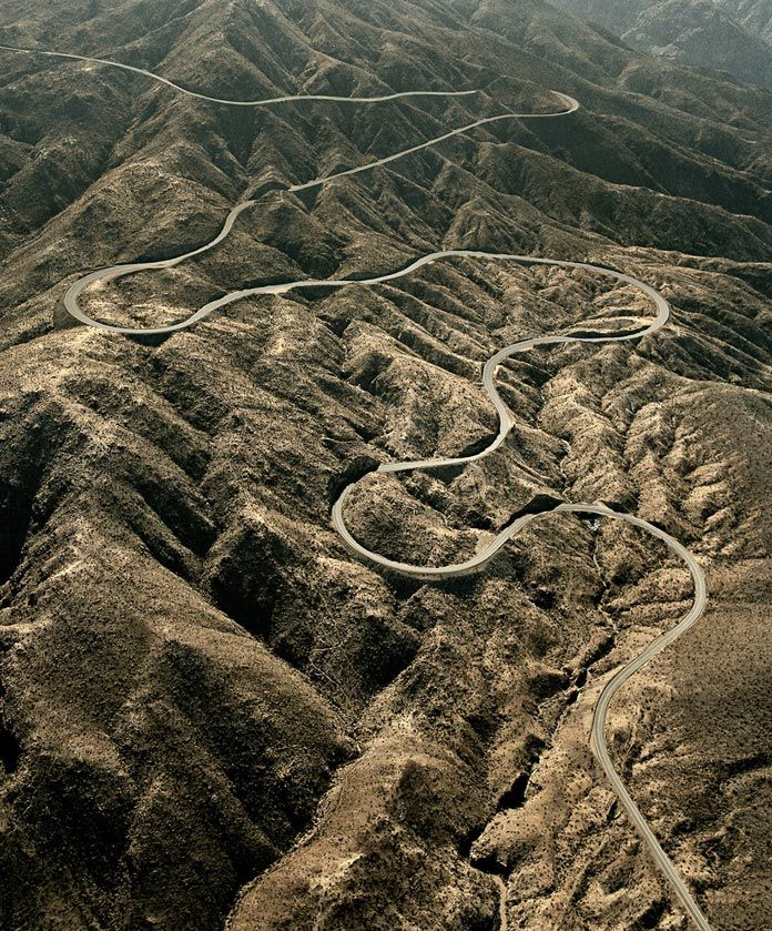 A winding mountain road photographed from the air.