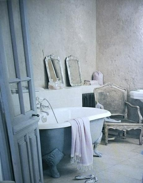 Blue and gray-white bathroom with French antiques.