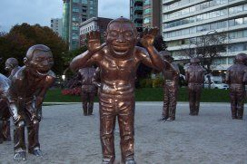 Just one of a series of sculptures by Yue Minjun of China dedicated to the people of Vancouver by the Wilson Family in 2009 as part of the Biennale Open Air Museum.