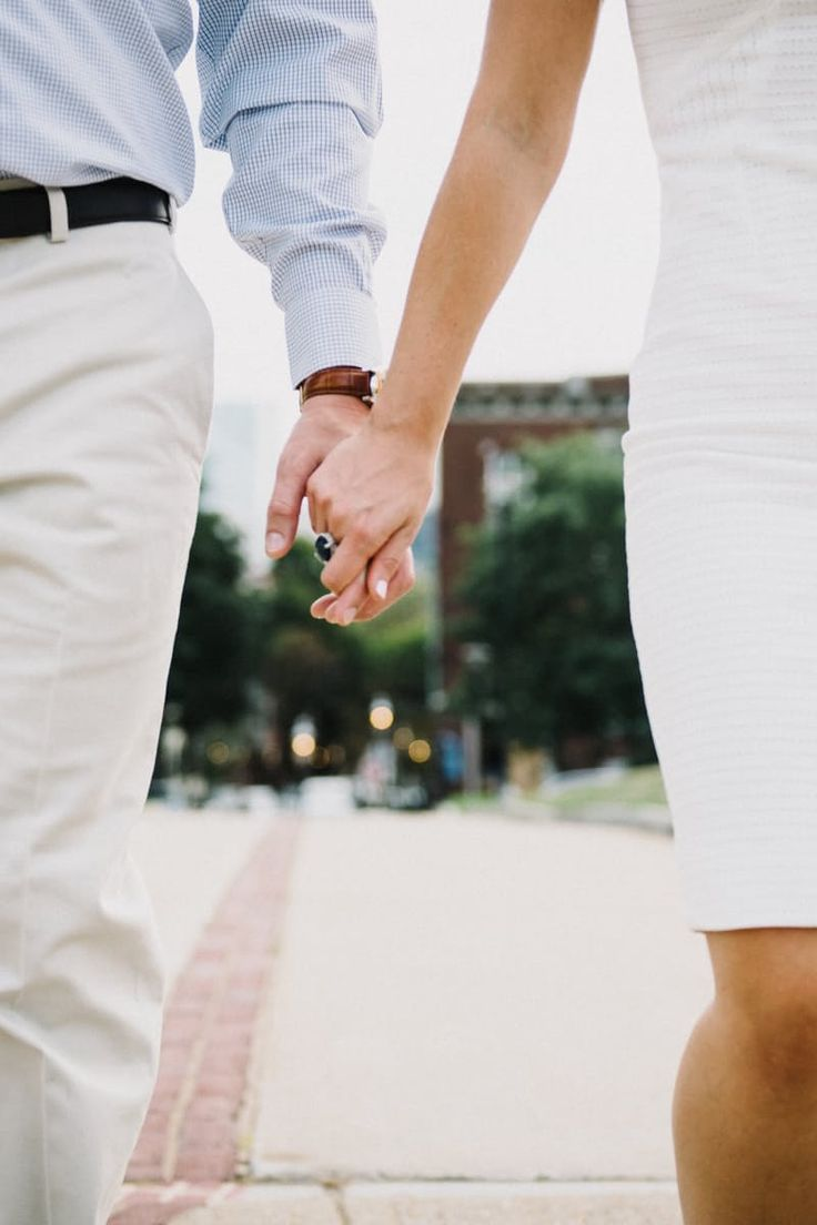 Woman Wearing White Tube Dress Holding Man's Hand