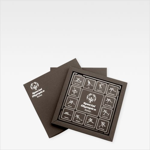 "Brand. ""More Than Chocolate"" describes all designs including photo by 100% chocolate only Using contrast ratio of white chocolate on dark chocolate. Customer. ""Special Olympic Korea"""