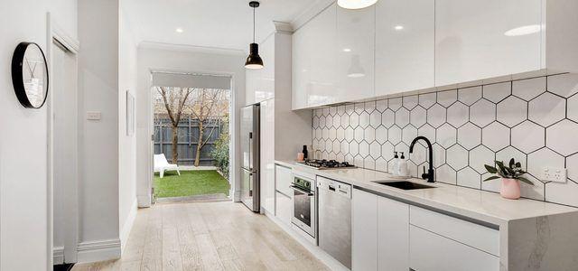 10 Absolutely Stunning White Modern Kitchen Ideas Hunker White Modern Kitchen White Backsplash Trendy Kitchen Backsplash
