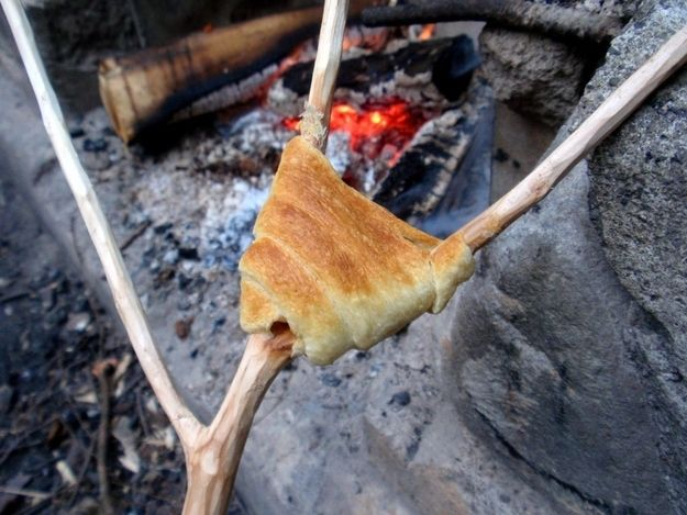 41 Camping Hacks That Are Borderline Genius - 8, 9 ,18, 20, 28 30, 31, 32, 33 - many of these are ridiculous but some fun ideas : crescent rolls to roast, starburst to roast, foil+waffle cone+ fruits + chocolates and marshmallows --> roast, sage and rosemary over the coals, polenta as dinner food, laundry detergent as hand-washing, big folgers coffee can and TP holder,