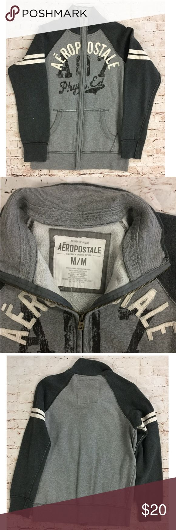 """Aeropostale Men's Grey Zip Up Sweater Grey and white Aeropostale men's zip up sweater, size medium.  Cannot be modeled, but measurements are provided below. All garments come from a smoke-free home and have no flaws unless stated above. Feel free to ask any questions or make offers!  Approximate Measurements:     Length: 28""""     Underarm to underarm: 23""""     Waist: 21"""" Aeropostale Sweaters Zip Up"""