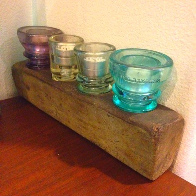 Old glass insulator candle holder