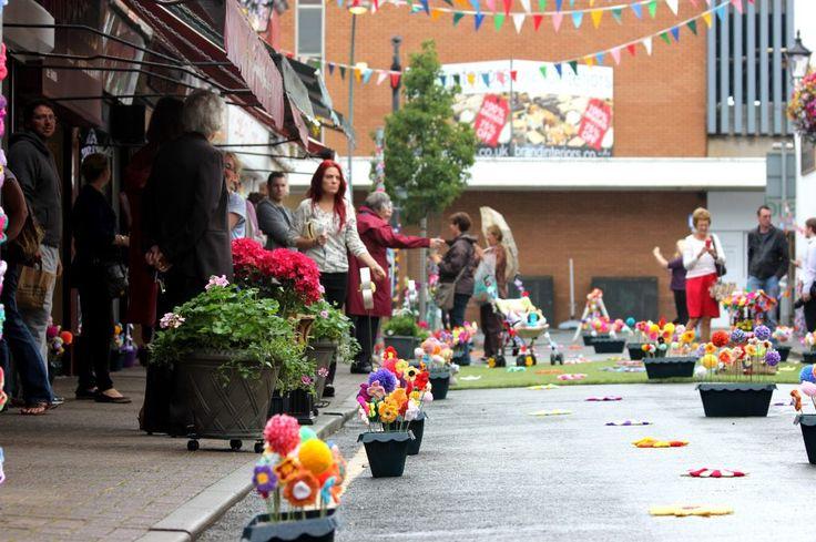 People enjoying the yarn 'bombing' on Wesley Street, Southport