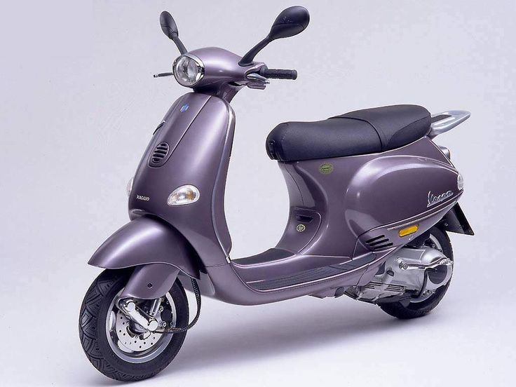 Vespa ET4 150cc, 1999 - First Piaggio scooter equipped with the new generation 4-stroke Leader engine, now on the 125cc model too.  Vespa ET4 50cc, 2000 - The first small Vespa with a 4-stroke engine, combining lively performance that will make no one regret the 2-stroke with quiet running and the reduction of polluting emissions. Fuel economy is outstanding: the Vespa ET4 50 has the highest range in the 50 cc class, with approx. 500 km on a full tank.